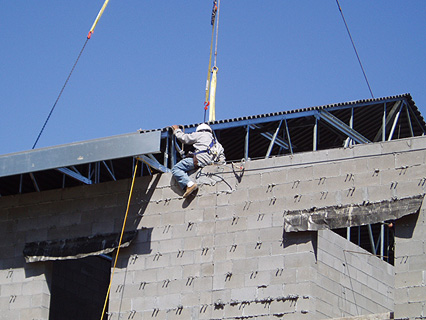 man securing roof section